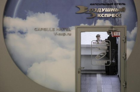 "A man stands at the reception of the Capsule Hotel ""Air Express"" in Moscow's Sheremetyevo airport June 27, 2013. REUTERS/Stringer"