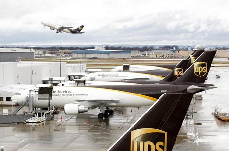 United Parcel Service aircrafts are being loaded with air containers full of packages bound for their final destination at the UPS Worldport