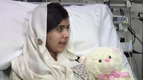 Pakistani schoolgirl, Malala Yousufzai, who was shot in the head by the Taliban for advocating girls' education, is seen sitting in her hosp
