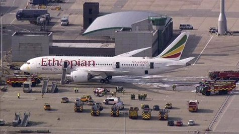 Emergency crew surrounds a Boeing 787 Dreamliner, operated by Ethiopian Airlines, which caught fire at Britain's Heathrow airport in this Ju