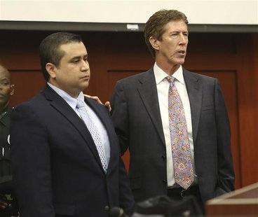 Defense counsel Mark O'Mara has George Zimmerman stand in the courtroom for the jury during defense closing arguments at his trial at the Se