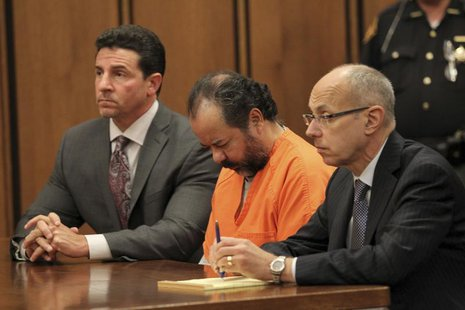 Ariel Castro, 52, sits with his head down between his attorneys Jaye Schlachet (R) and Craig Weintraub (L) during his pre-trial hearing on c