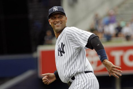 New York Yankees batter Derek Jeter reacts as he warms up for his game against the Kansas City Royals before their MLB American League baseb