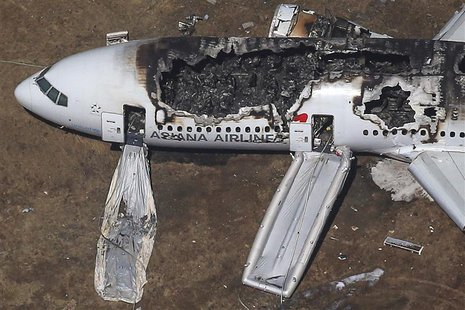 An Asiana Airlines Boeing 777 plane is seen after it crashed while landing at San Francisco International Airport in California, in this fil