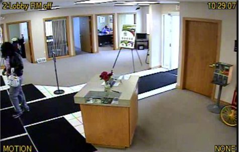 Green Bay Police are looking for this suspect, who robbed the Pioneer Credit Union at 1065 Velp Avenue on July 3, 2013. (Photo from GBPD).