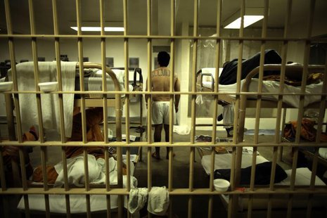 An inmate stands in his cell at the Orange County jail in Santa Ana, California, May 24, 2011. REUTERS/Lucy Nicholson