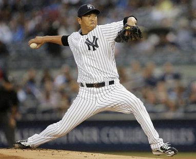 New York Yankees starting pitcher Hiroki Kuroda throws a pitch to the Minnesota Twins in the first inning of their MLB American League baseb