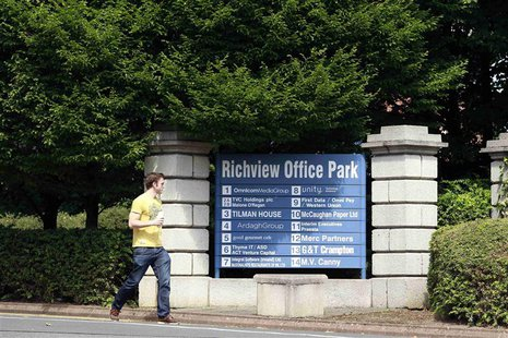 A man walks past the Richview Office Park which houses Western Union offices in Dublin July 8, 2013. REUTERS/Cathal McNaughton