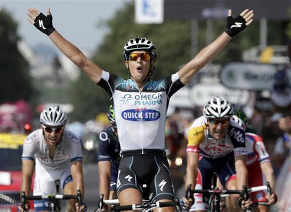 Omega Pharma-Quick Step team Matteo Trentin of Italy celebrates as he crosses the finish line to win the 191 km fourteenth stage of the cent