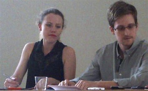 Former intelligence agency contractor Edward Snowden and Sarah Harrison (L) of WikiLeaks speak to human rights representatives in Moscow's S