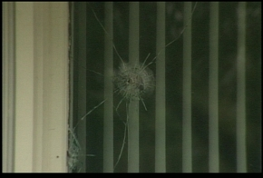 Bullet holes in a house in East Grand Forks, Minn.