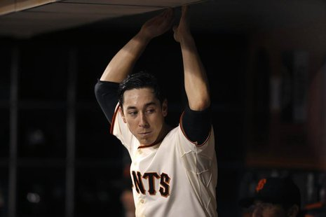 San Francisco Giants starting pitcher Tim Lincecum rests in the dugout during the seventh inning of his MLB American League baseball game ag