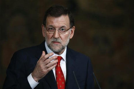 Spain's Prime Minister Mariano Rajoy gestures during a presentation on social action entities at the Moncloa Palace in Madrid July 11, 2013.