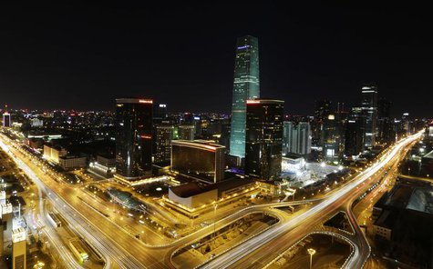 A general view of the China World Trade Centre Tower III is seen before Earth Hour in Beijing's central business district March 23, 2013. RE