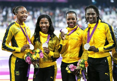 (L-R) Jamaica's Sherone Simpson, Shelly-Ann Fraser-Pryce, Veronica Campbell-Brown and Kerron Stewart pose with their silver medals in the wo