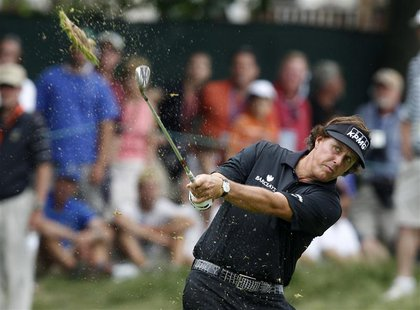 Phil Mickelson of the U.S. makes his second shot on the eighth hole during the final round of the 2013 U.S. Open golf championship at the Me