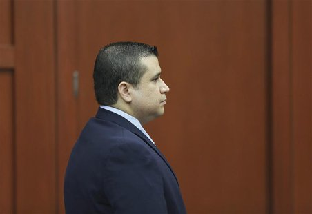 George Zimmerman stands alone at the defense table moments after the jury left the courtroom to deliberate during his trial in Seminole circ
