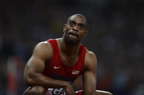 Tyson Gay of the U.S. reacts after finishing fourth in the men's 100m final during the London 2012 Olympic Games at the Olympic Stadium in t