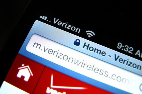 A photo illustration shows the Verizon wireless carrier icon on a mobile phone screen in Encinitas, California June 6, 2013. REUTERS/Mike Bl