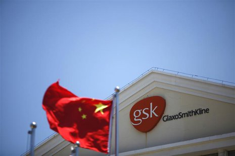 A Chinese national flag flutters in front of a GlaxoSmithKline (GSK) office building in Shanghai in this July 12, 2013 file photo. REUTERS/A