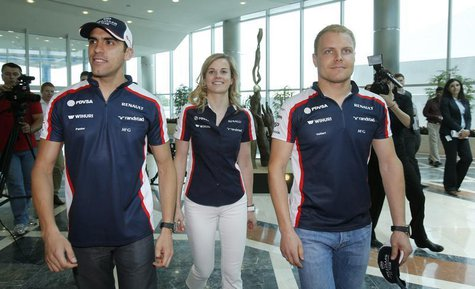 Williams Formula One drivers Pastor Maldonado (L) of Venezuela and Valtteri Bottas (R) of Finland and test-driver Susie Wolff of Britain wal