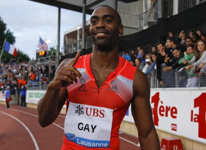 Tyson Gay of the U.S. gestures after winning in the 100m event of the Lausanne Diamond League meeting in Lausanne, July 4, 2013. REUTERS/Den