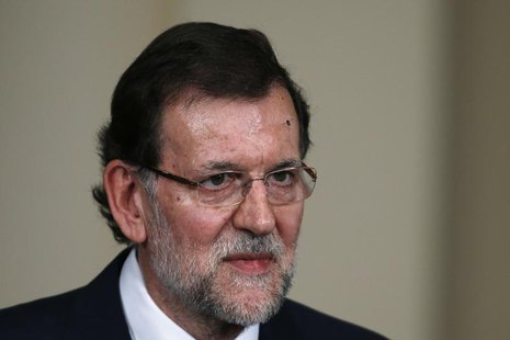 Spain's Prime Minister Mariano Rajoy attends a presentation on social action entities at the Moncloa Palace in Madrid July 11, 2013. REUTERS