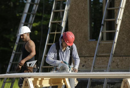 "Carpenters cut fascia trimwork at a housing site at Mid-Atlantic Builders ""The Villages of Savannah"" development in Brandywine, Maryland May"