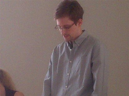 Former intelligence agency contractor Edward Snowden speaks to human rights representatives in Moscow's Sheremetyevo airport in this July 12