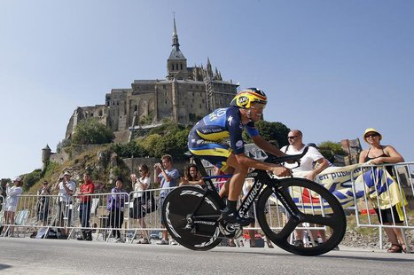 Team Saxo-Tinkoff rider Alberto Contador of Spain cycles past the Mont Saint-Michel during the 32 km individual time trial eleventh stage of