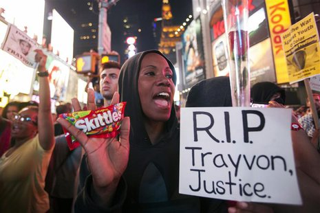 Protester Keisha Martin-Hall holds a bag of Skittles as she participates in a rally in response to the acquittal of George Zimmerman in the