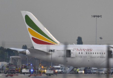 Emergency services attend to a Boeing 787 Dreamliner, operated by Ethiopian Airlines, after it caught fire at Britain's Heathrow airport in