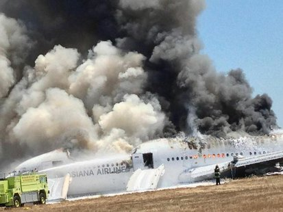 Asiana Airlines Boeing 777 is engulfed in smoke on the tarmac after a crash landing at San Francisco International Airport in California Jul
