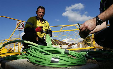 NBN Co. workers arrange fiber-optic cables used in the National Broadband Network in west Sydney July 11, 2013. REUTERS/Daniel Munoz
