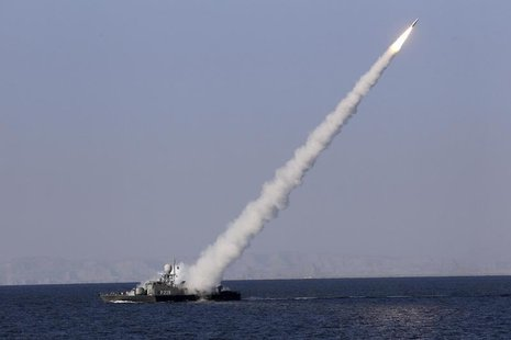 A new medium-range missile is fired from a naval ship during Velayat-90 war game on Sea of Oman near the Strait of Hormuz in southern Iran J