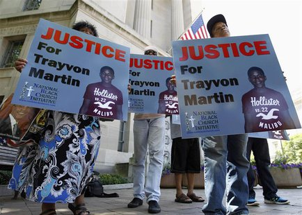 Members of the National Black Church Initiative protest as they ask for justice for Trayvon Martin, outside the Department of Justice in Was