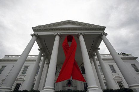 An AIDS ribbon hangs from the North Portico of the White House in Washington, November 30, 2010. REUTERS/Jim Young