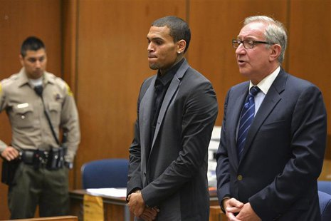 Singer Chris Brown and attorney Mark Geragos (R) attend a probation progress hearing in Los Angeles Superior Court July 15, 2013. REUTERS/Al