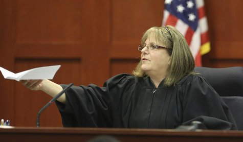 Judge Debra Nelson hands the verdict to the clerk of courts announcing George Zimmerman is not guilty in the 2012 shooting death of Trayvon