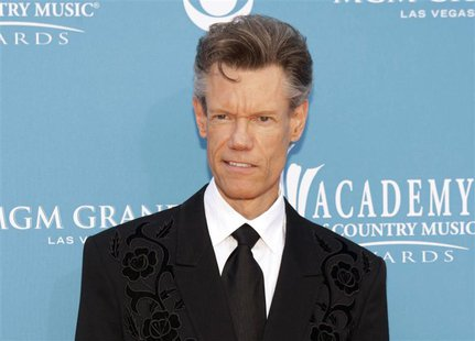 Singer Randy Travis arrives at the 45th annual Academy of Country Music Awards in Las Vegas, Nevada in this April 18, 2010 file photo. y to