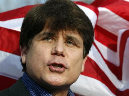 Former Illinois Governor Rod Blagojevich makes a statement to reporters outside his Chicago home one day before reporting to federal prison