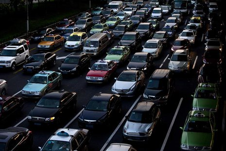 Lines of cars are pictured during a rush hour traffic jam in central Shanghai in this July 11, 2013 file photo. REUTERS/Aly Song/Files