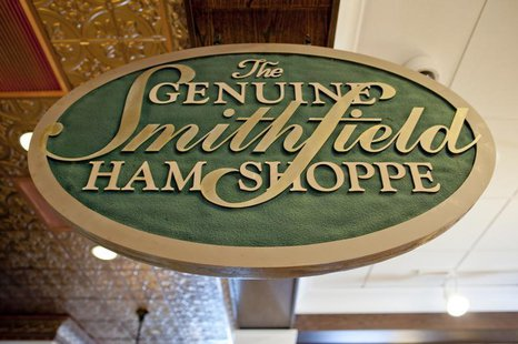 A sign advertising Smithfield hams hangs at the Taste of Smithfield restaurant and gourmet market in Smithfield, Virginia May 30, 2013. REUT