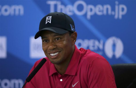 Tiger Woods of the U.S. speaks during a news conference following a practice round ahead of the British Open golf championship at Muirfield
