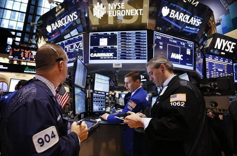 Traders work on the main trading floor of the New York Stock Exchange (NYSE) shortly after the opening bell in New York, May 20, 2013. REUTE