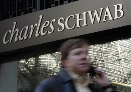 A man walks past a Charles Schwab Investment branch in Washington in this January 19, 2010 files. REUTERS/Jim Young/Files