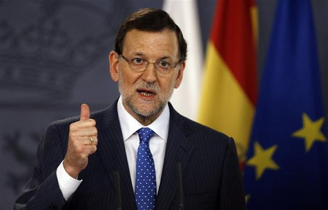 Spain's Prime Minister Mariano Rajoy gestures during a joint news conference with his Polish counterpart Donald Tusk (not pictured) at Moncl