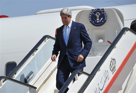 U.S. Secretary of State John Kerry steps off his plane upon his arrival at Queen Alia International Airport in Amman, July 16, 2013. REUTERS