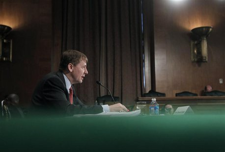 Consumer Financial Protection Bureau Director Richard Cordray delivers his organization's semi-annual report to Congress at a Senate Banking