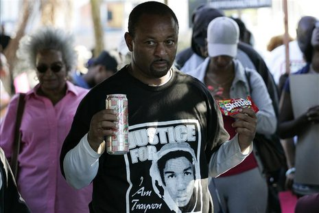 Community activist Najee Ali holds Skittles and an ice tea during a peaceful protest of the acquittal of George Zimmerman for the 2012 shoot